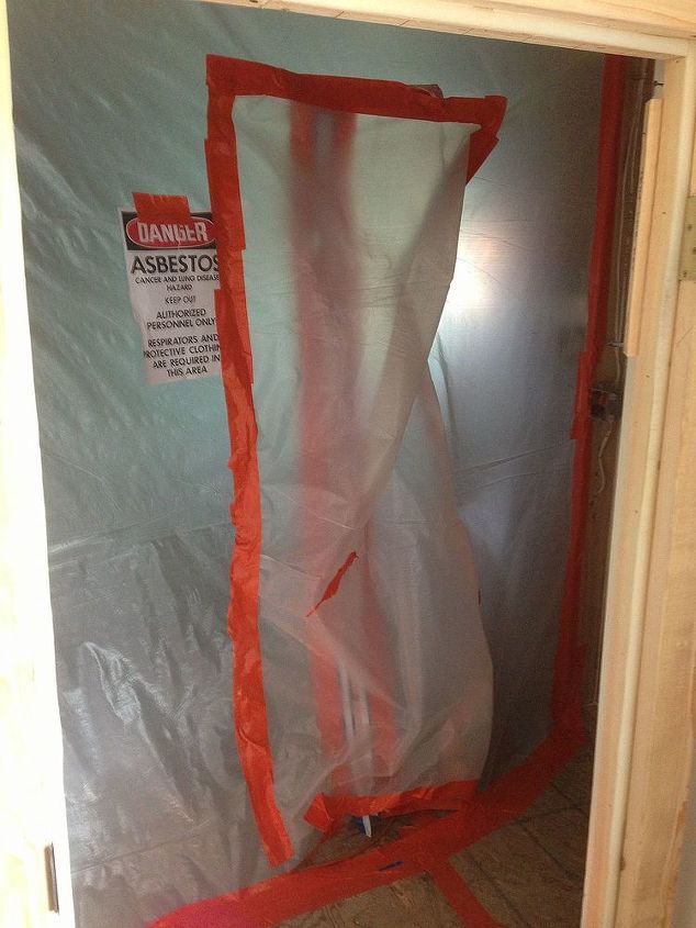 The flooring contained asbestos and needed  remediation. A good reason to always test for presence of hazardous materials prior to demo.