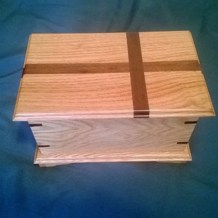 #4 this one is oak with a walmut cross inset into the top. The finish is natural.