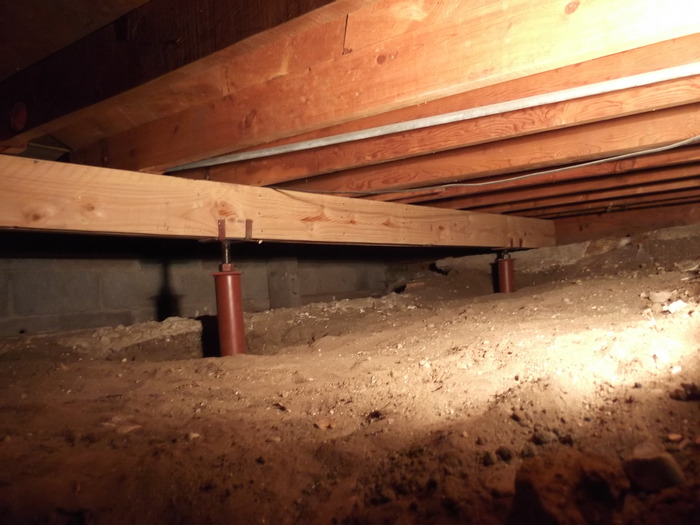 We restored the structural integrity of this Denver, CO crawl space by installing SmartJack, crawl space jacks.