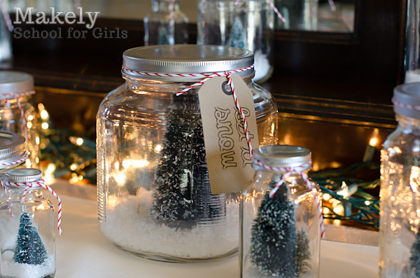 """4.  Last, we screwed the lids on the jars and tied pieces of red and white bakers twine around the lids.  On a few of the jars, we also tied little """"gift tags"""" that I designed on the computer."""