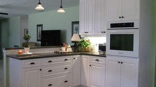 q i am going to be remodeling a kitchen in a little home in florida soon, home decor, home improvement, kitchen design, Cooking area after The 3 drawers under the smooth cooktop surface conveniently store pots pans lids cooking utensils pot holders No more getting down on my hands and knees to look for pots or pans in the back of the cabinet