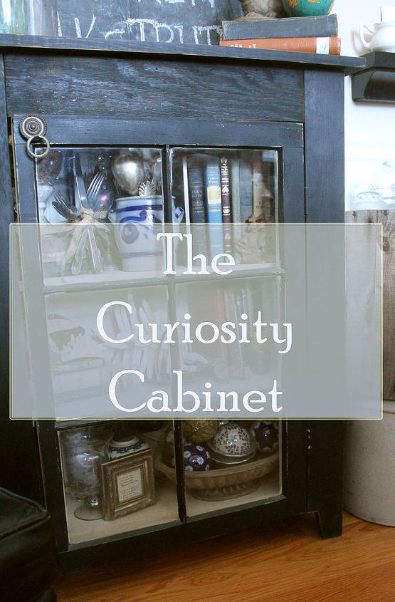 a handmade curiosity cabinet and a gallery wall of vintage maps, home decor, painted furniture, repurposing upcycling, wall decor, woodworking projects