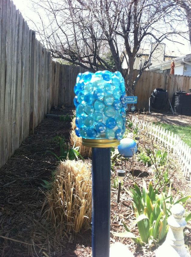 And then screwed the jar onto the lid. Not only does it shimmer in the sunlight, it gives off a soft blue glistening glow at night thanks to the solar light inside.  Should the light quit working, I can simple untwist it and replace the battery in the light.