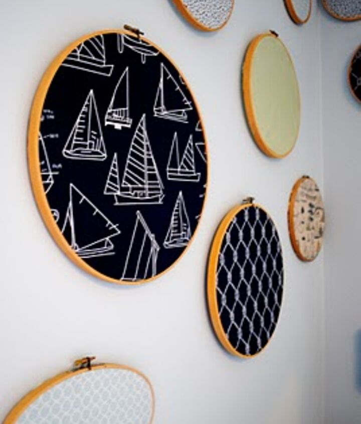 Embroidery hoops hold nautical themed fabric for a quick and easy wall display.