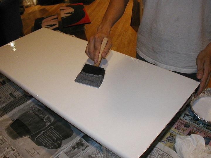 Here's the process. I took the cabinet doors off the hinges and applied plain white Elmer's glue to the surface.