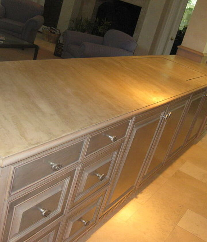 A client recently asked me to resurface her counter top between the kitchen and the family room. Weight and durability was a concern because if you look at the far end of the counter there is an opening under which a TV is hidden...
