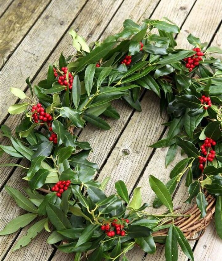 Continue adding bunches of greens (and reds!) until the wreath is all filled up. Secure each bunch well with the twine.