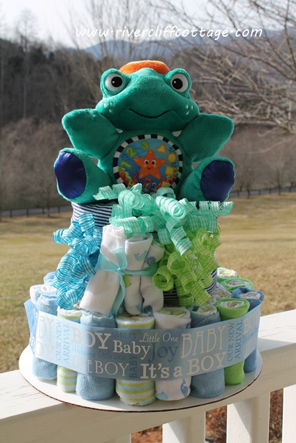 sea turtle diaper cake, crafts, Diapers wash cloths baby blankets and lotion topped off with a musical sea turtle