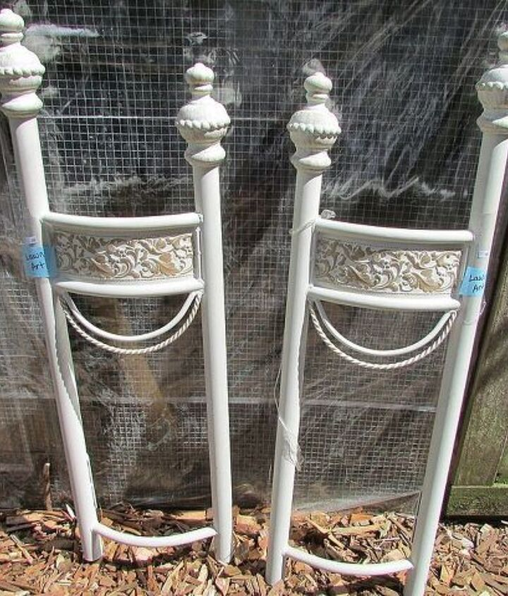 Two metal decorative post? They have a slight half circle to them.
