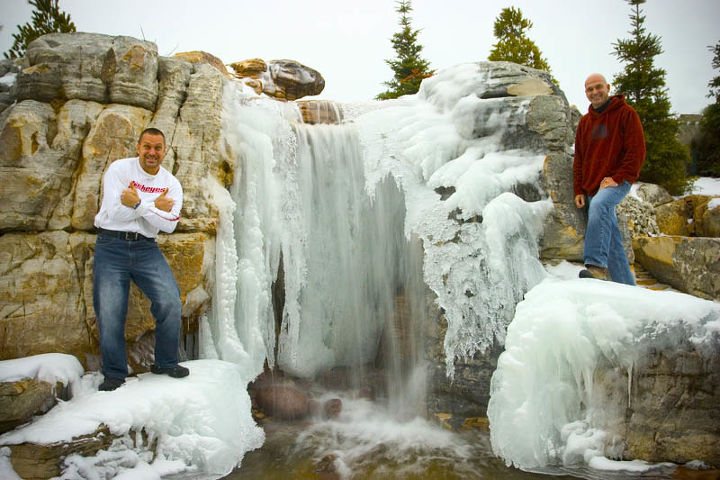 Aquascape owner Greg Wittstock (at left) with Ed Beaulieu in front of the waterfalls.