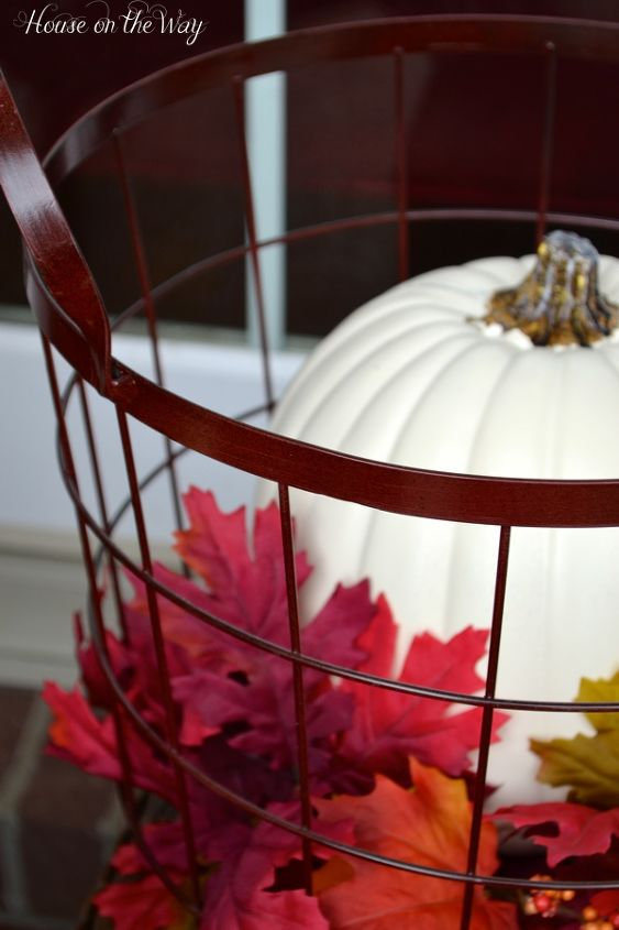 I brought out my two red metal wire baskets and filled them with pumpkins and leaves.