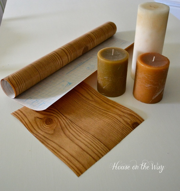 Wood-like Contact paper from the Dollar Tree is the perfect cover for your candles.