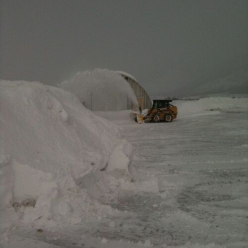 My hubby blowing the snow away from the driveway