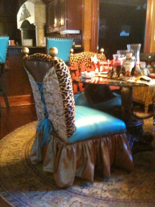 I found shorter back chairs and added antique gold finials, and I reupholstered with a sassy skirt, and corset back that I tied with turquoise ribbon I laced thru eyelet grommets that I added for some more sassy style.