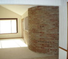 q help can you help redo this living room rock brick bookshelf off center window, dining room ideas, fireplaces mantels, home decor, windows, Right side of living room shows same window curved brick wall and planter