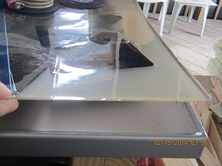 q outdoor bartop, countertops, diy, how to, outdoor living, patio, Epoxy layer can be lifted in one complete piece with pictures embedded