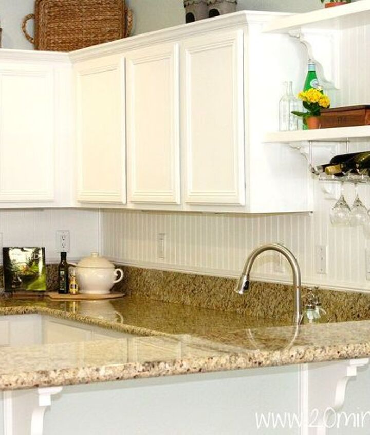 Kitchen: custom shelves and wine rack above sink