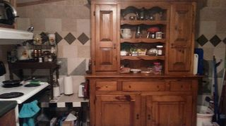 kitchen furniture, painted furniture, repurposing upcycling, I bought this at a furniture store going out of business at a good deal It holds all of my food items I re purposed an old fish tank stand Lt with old tiles laying around stacked a piano bench on top of it for more stuff