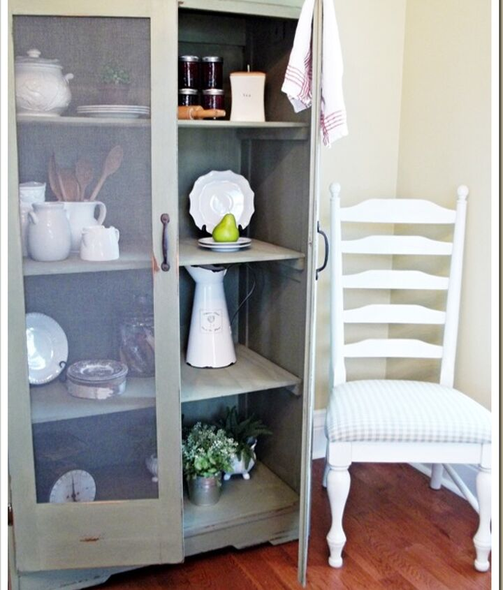 Armoire to handy kitchen storage. Painted with Acadia Pear Milk Paint.  Light distressing gives this cabinet a well used appearance.
