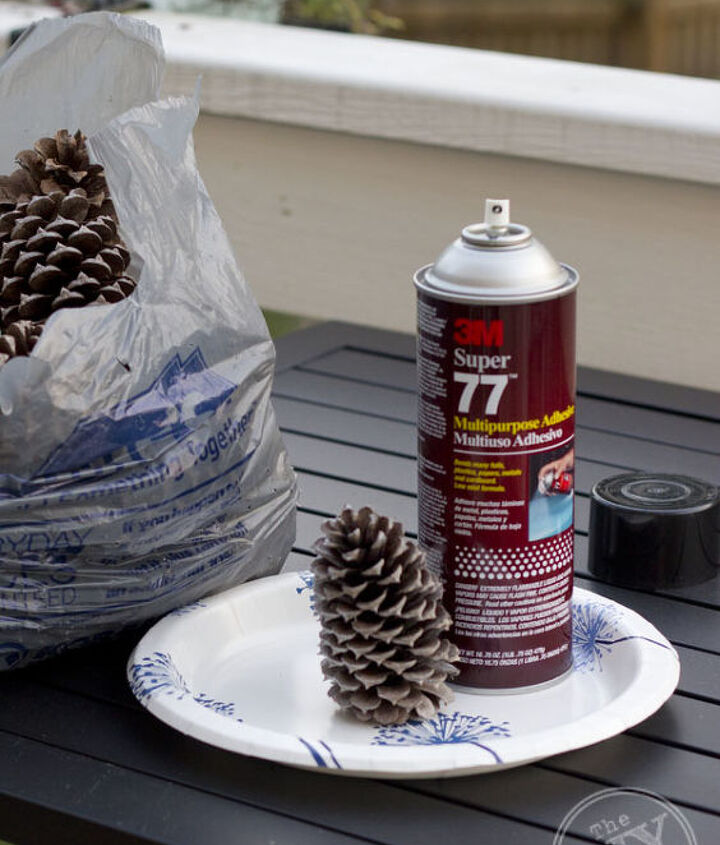 winter wonderland holiday lamp decorating challenge, lighting, seasonal holiday decor, Spray your pine cones with spray adhesive sprinkle with glitter