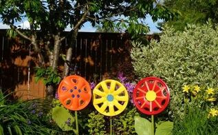 hubcap flower yard art, crafts, flowers, gardening, painting, Use broken shovel handles as stems and enjoy the flowers as yard art