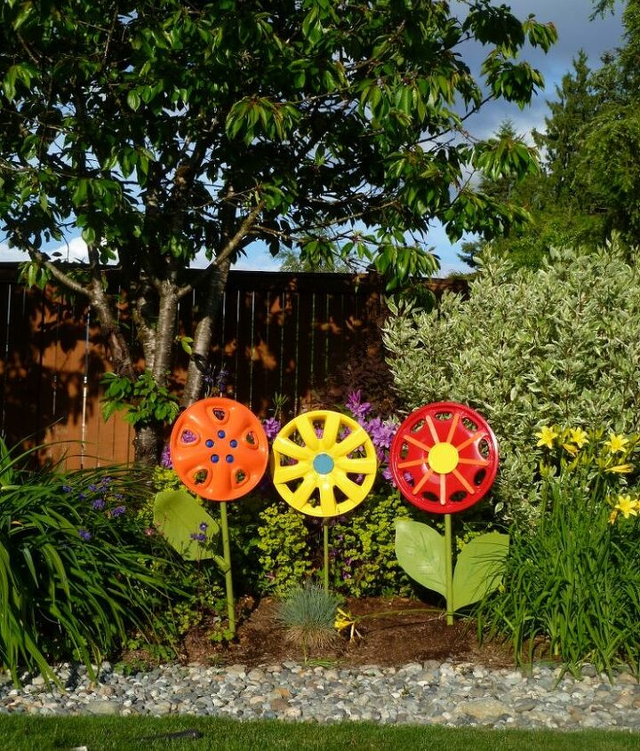 Use broken shovel handles as stems and enjoy the flowers as yard art.