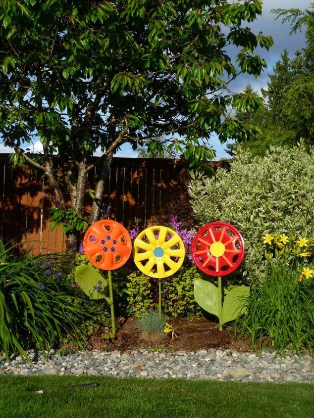 Use broken shovel handles as stems and enjoy the flowers as yard art.