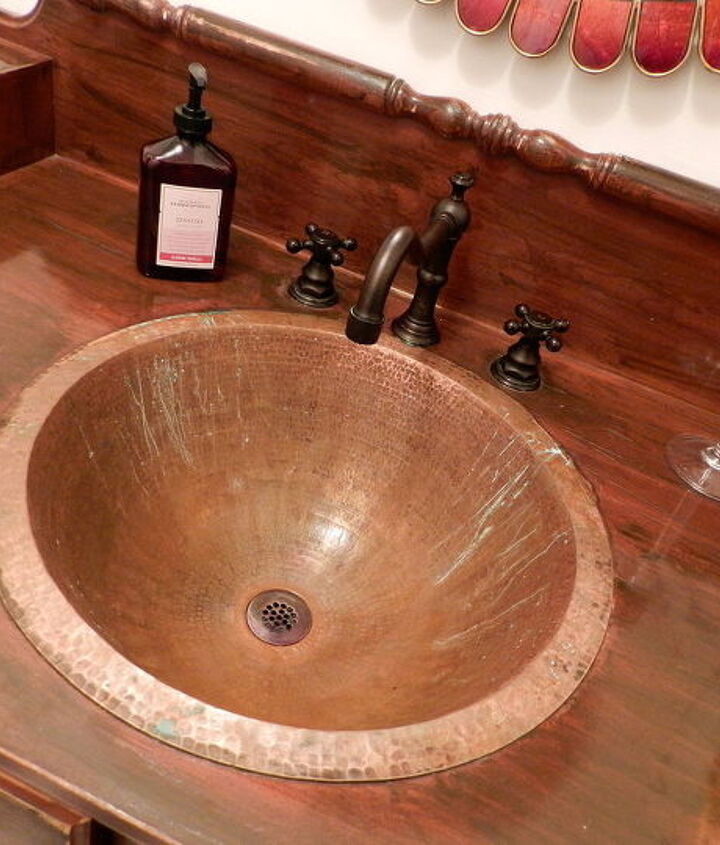 If you look closely you can see the green and dullness.  We have tried polishing it, but since I sanded it...it's doomed!!!  http://www.redheadcandecorate.com/4/post/2012/09/my-copper-sink-is-ruined.html