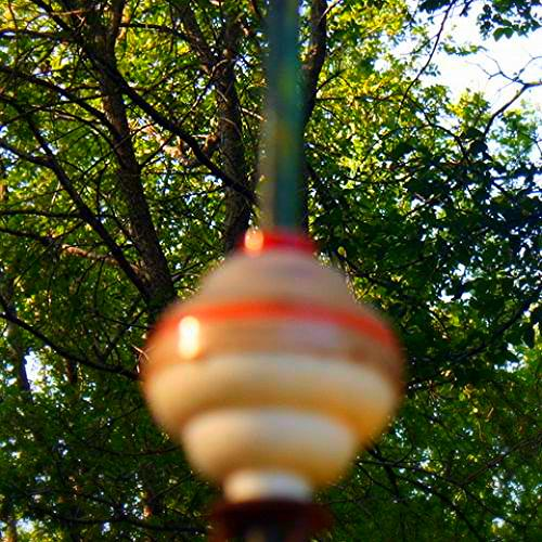 Sorry, about the quality, but this shows the colorful weathervane's center sphere.