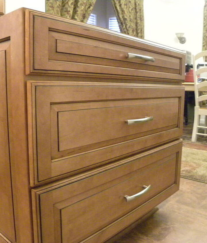 "Three-drawer base (36""w) at the end of the peninsula. Same bar pulls as the rest of the drawers, but much larger."