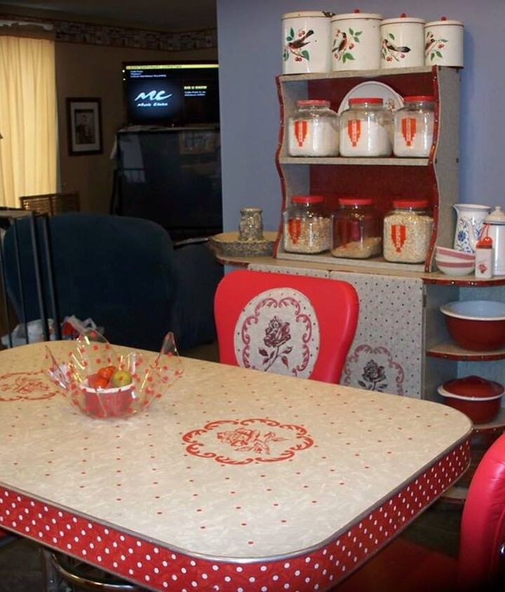 1940's kitchen table and chairs with matching hutch. I will post photos of the table and chair renovation later. I bought the glass jars at Walmart, painted lids red and printed retro stickers to label them.
