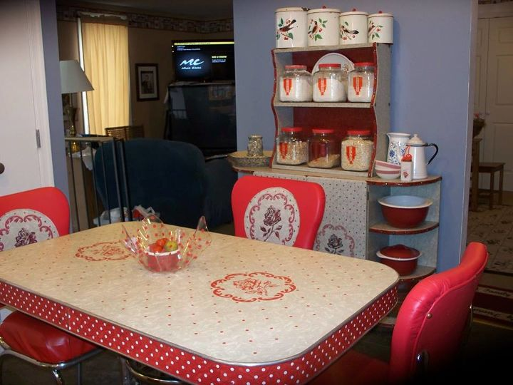 my 1940 s inspired kitchen renovation, home improvement, kitchen design, 1940 s kitchen table and chairs with matching hutch I will post photos of the table and chair renovation later I bought the glass jars at Walmart painted lids red and printed retro stickers to label them