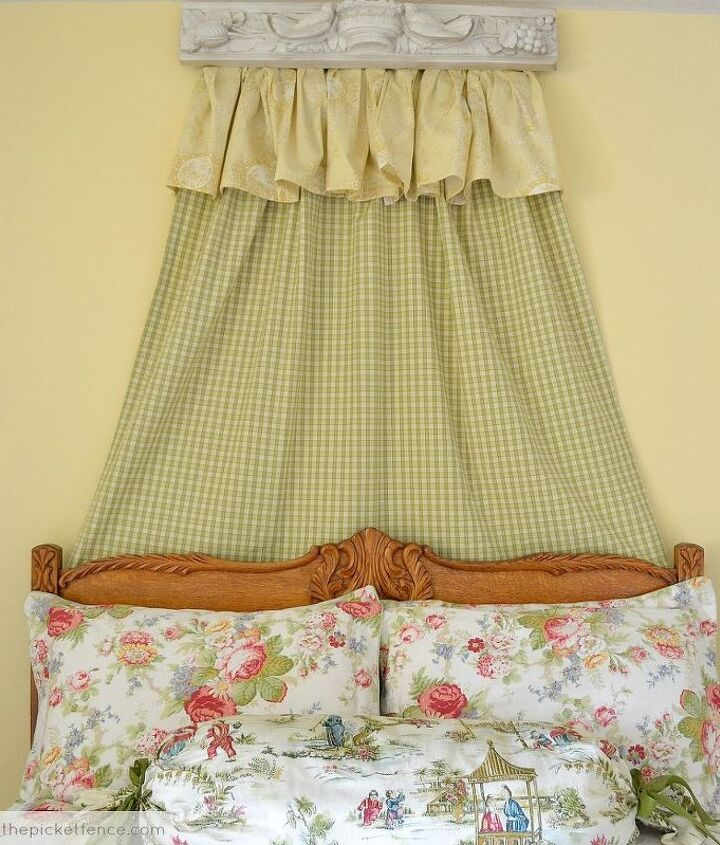 I used a drapery panel and the dust ruffle from my daughter's crib to soften the wall behind the bed.