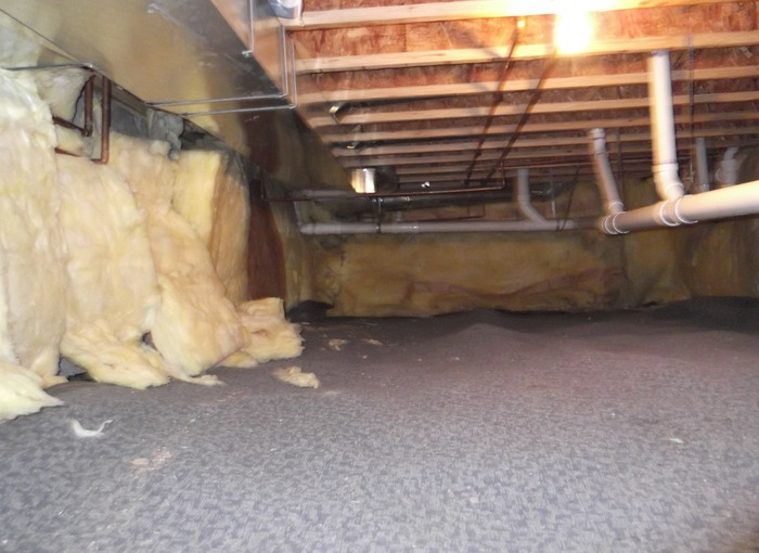 This homeowner in Aurora, CO tried to insulate his crawl space by applying fiberglass bats on the walls. Fiberglass is not good for crawl spaces because it absorbs water and loses R-Value when wet. It also tends to sag and fall off.