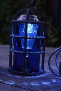 sensational recycled solar lights in the garden, outdoor living, repurposing upcycling, Marie Niemann s brilliant blue lamps from Bud Light beer bottles amazing upcycle