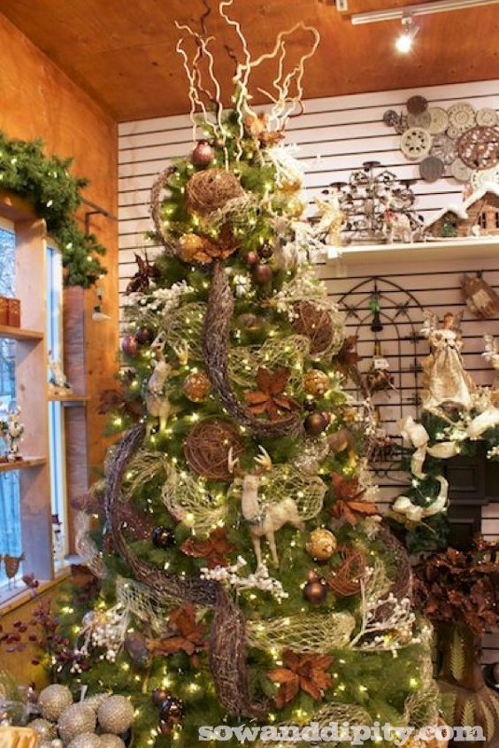 rustic bling holiday decor, seasonal holiday d cor, The tree has plenty of natural twigs grape vine garlands and balls and just the right amount of sparkle