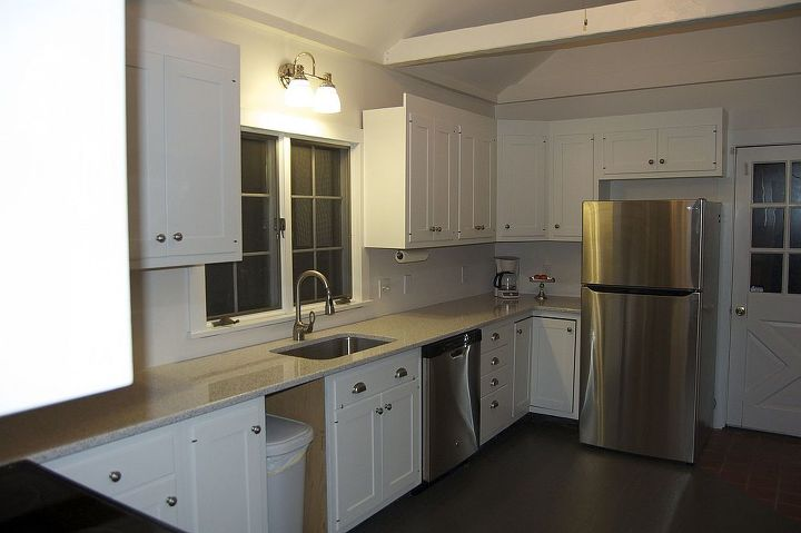 Gray solid stain on the floors, sparkly quartz counters and stainless appliances