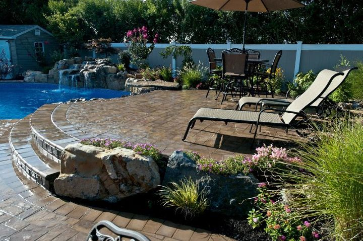 Raised Patios Flower Beds And Waterfall Make Backyard Appear Larger
