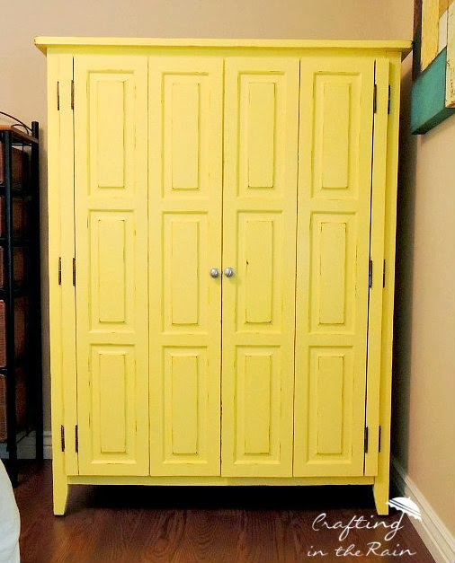 entertainment center as craft storage, painted furniture