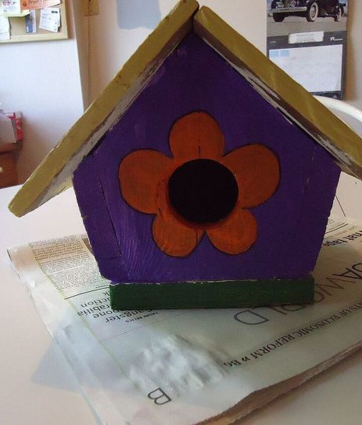 I love purple so I started by applying a coat to the front and back of bird house.