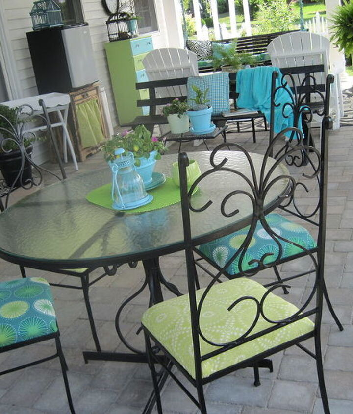 Vintage wrought iron patio set from a yardsale for 25$. Most of the things on the patio are from yardsales or were things we already had. Stand under the small fridge was curbside find. It all came together with paint and fabric.