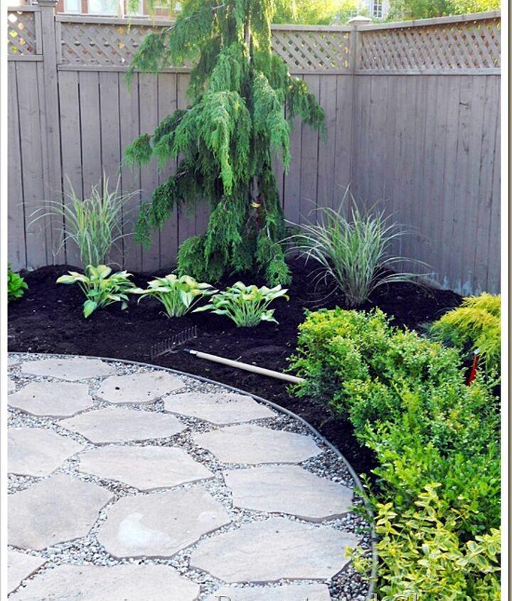 Fill with pea stone. Landscape around the patio