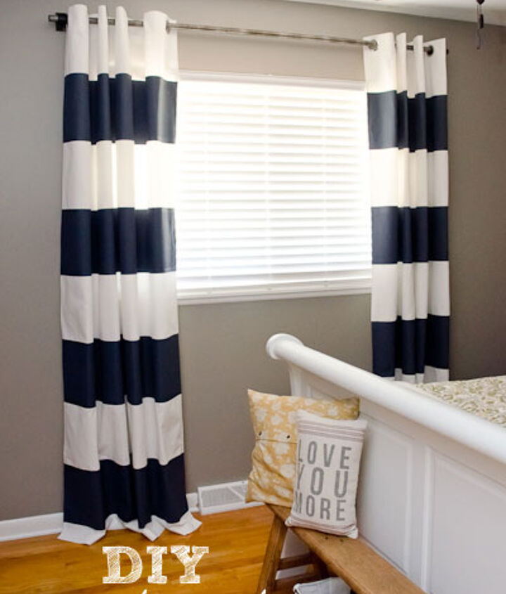 Painted white curtains with navy flat latex paint.