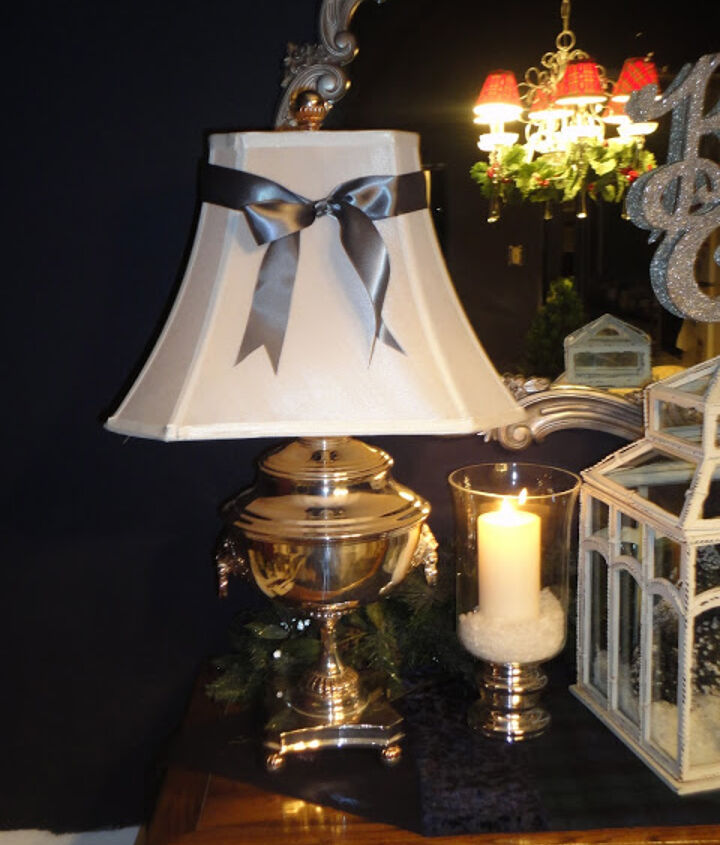 Ralph Lauren Samovar lamps decorated with silver ribbons.