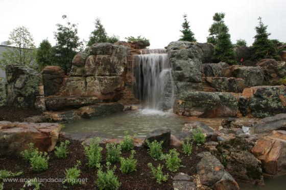 Finished Aquascape Ecosystem Fish Pond, Waterfall Pond. Behind these Waterfalls is a Cave! Constructed by the largest group of professional Pond Builders in the World:  Certified Aquascape Contractors