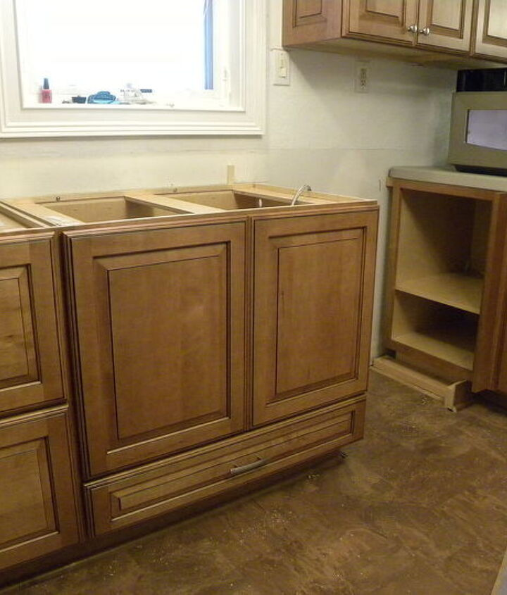 Sink base cabinet with drawer at the bottom to store dish towels, oven mitts, etc.