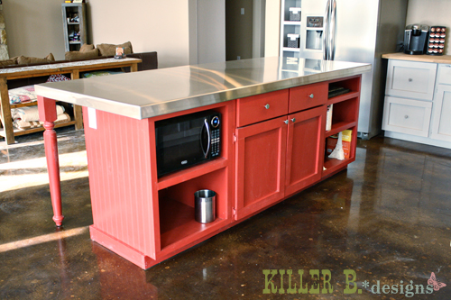 """Front of the kitchen island. We installed two plugs so we could """"build-in"""" our countertop microwave and have a plug for appliances"""
