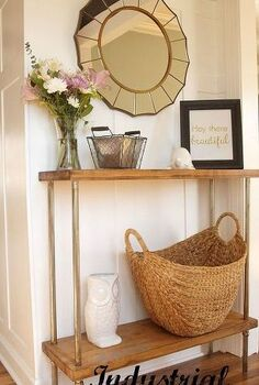 industrial console table tutorial, painted furniture, We added a gold sunburst mirror some art and baskets to finish off the space and give the table a more refined look