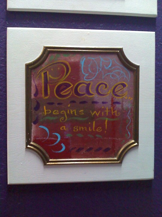 Peace does begin with a smile! I painted on a cabinet door.