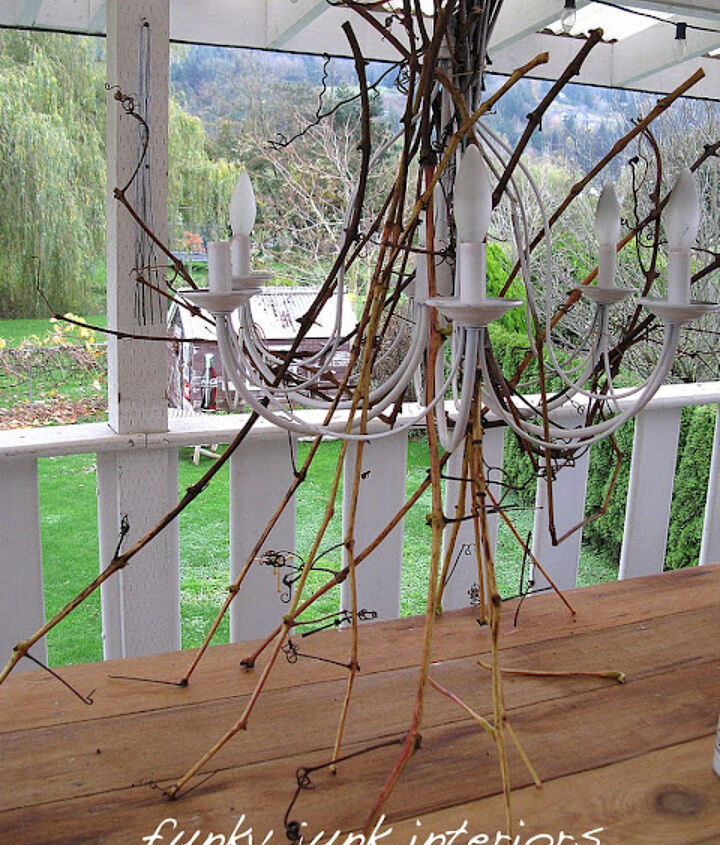 Starting with a thrift store chandy, I sprayed it white, then gathered up grapevines and willow tree branches, both while still green.